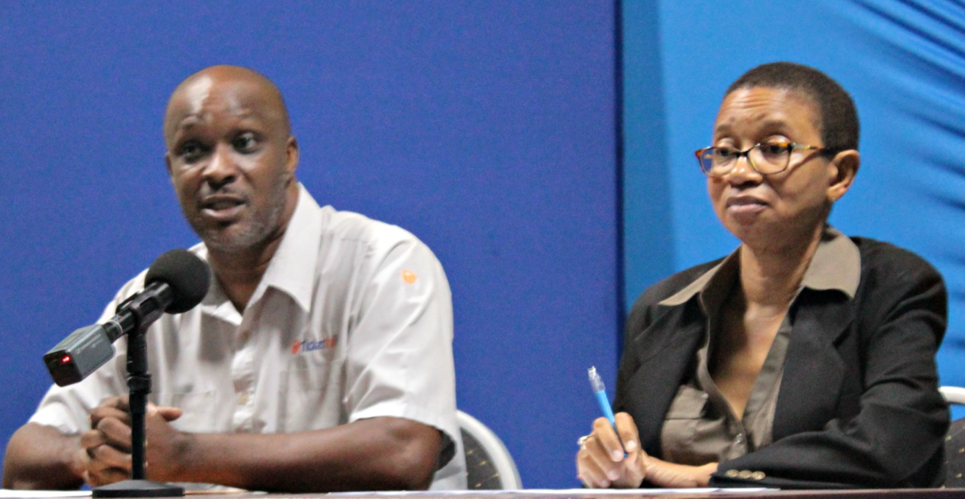 (L-R) Orlando Newton of Ticketpal Caribbean and Lori Webster of the Caribbean Broadcasting Corporation at the press launch of the I Am LIVE AID Project.