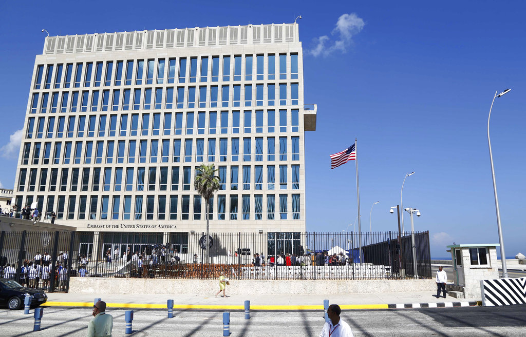FILE - In this Aug. 14, 2015, file photo, a U.S. flag flies at the U.S. embassy in Havana, Cuba. U.S. investigators are chasing many theories about what's harming American diplomats in Cuba, including a sonic attack, electromagnetic weapon or flawed spying device.
