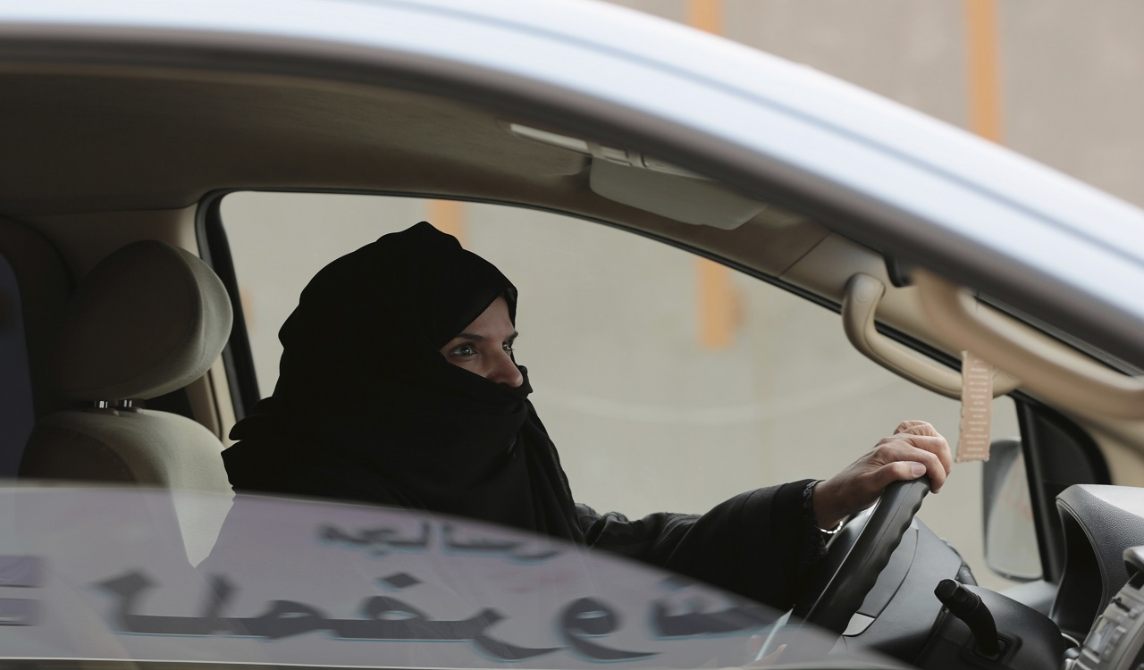 In this Saturday, March 29, 2014 file photo, Aziza Yousef drives a car on a highway in Riyadh, Saudi Arabia, as part of a campaign to defy Saudi Arabia's ban on women driving. Saudi Arabia says it will allow women to drive for the first time in the ultra-conservative kingdom.