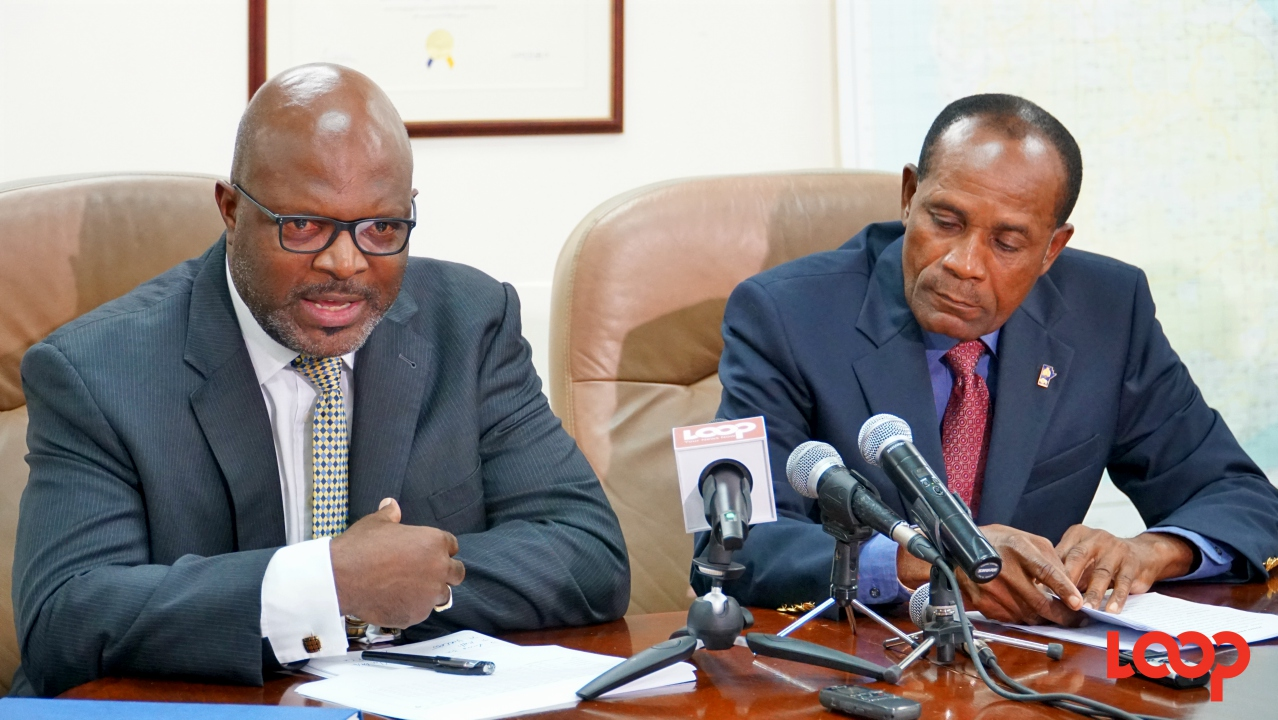 FILE - Attorney General Adriel Brathwaite and acting Commissioner of Police, Tyrone Griffith at a press conference in July 2017.