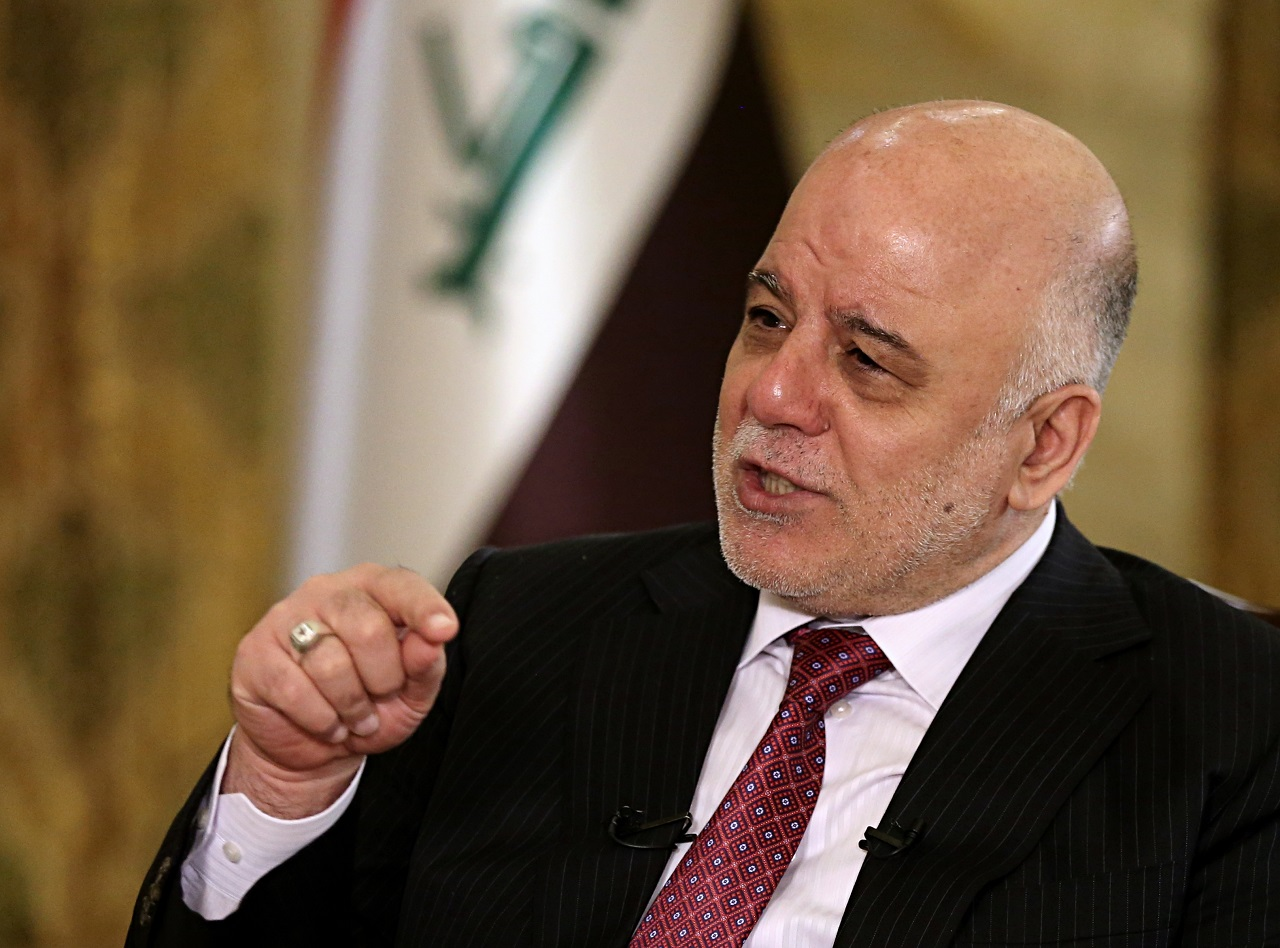Iraq's Prime Minister Haider al-Abadi speaks during an interview with The Associated Press in Baghdad, Iraq, Saturday, Sept. 16, 2017.