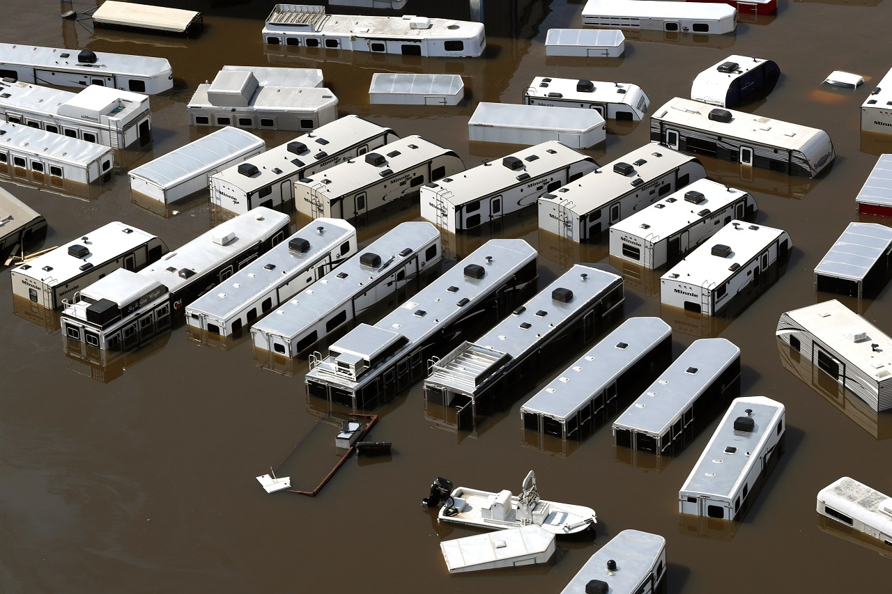 A line of recreational vehicles sit submerged by floodwaters of Tropical Storm Harvey on Friday, Sept. 1, 2017, near Vidor, Texas.