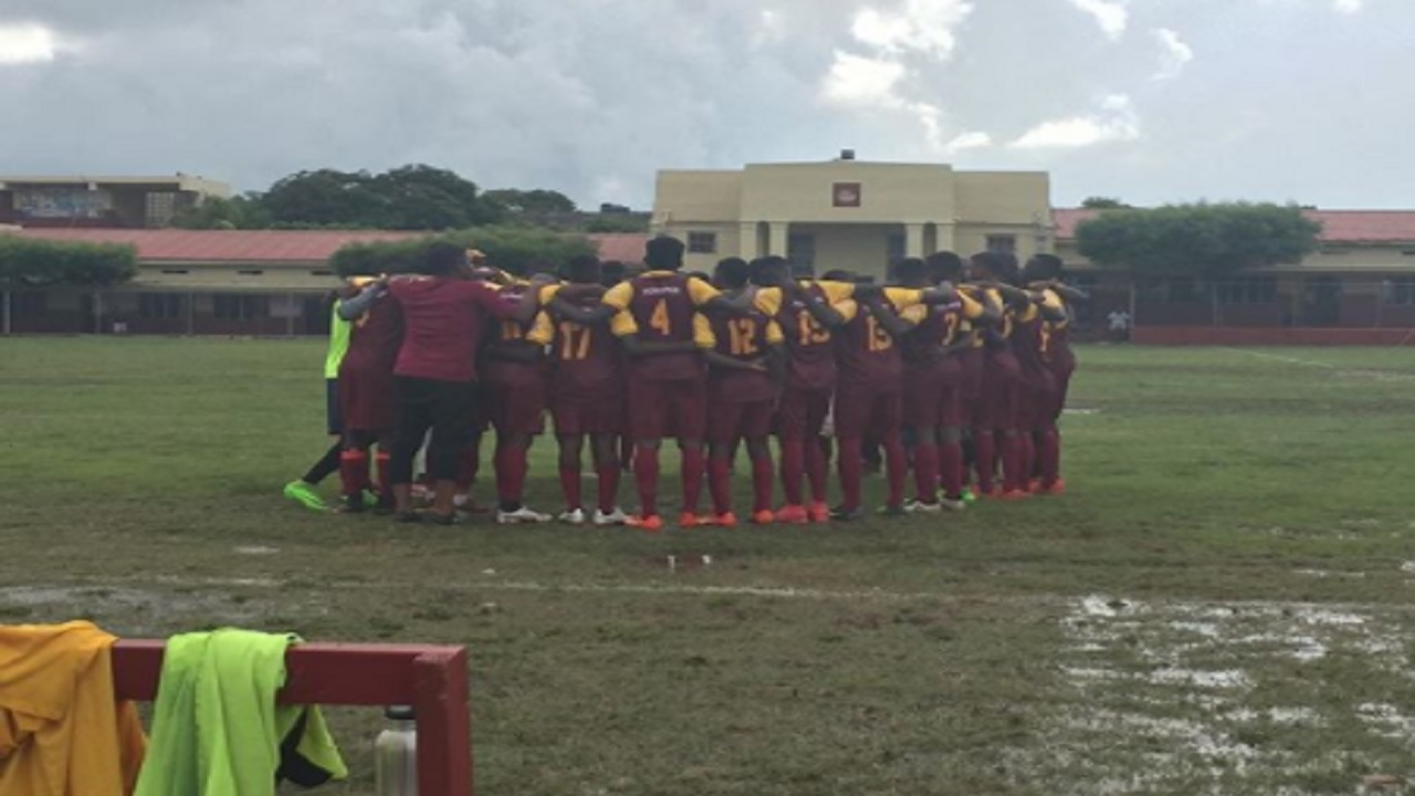 Wolmer's players get in a huddle ahead of the team's Manning Cup encounter against Pembroke Hall on Saturday. (PHOTO: Yardie Sports)