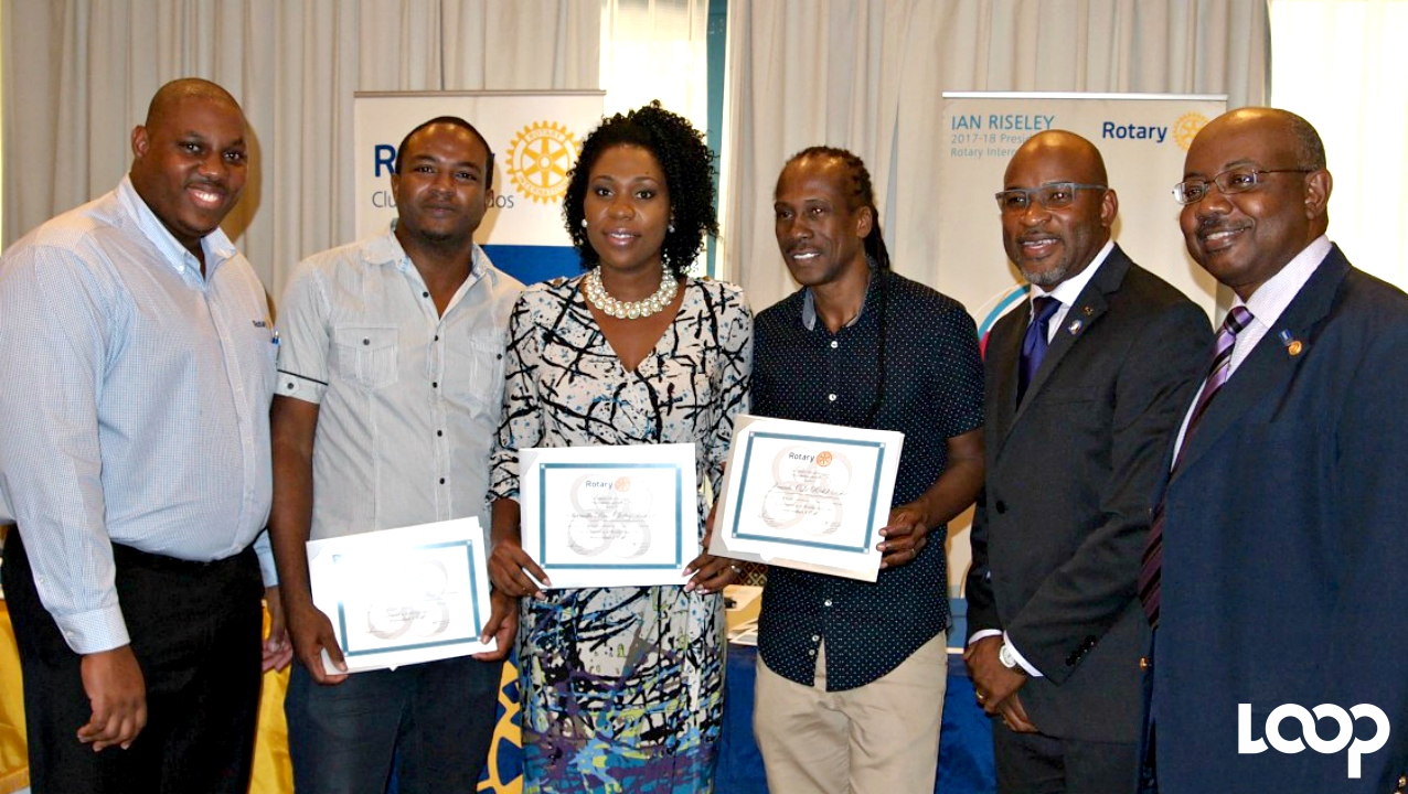 Recipients of Rotary Peace Ambassador awards: (second left) Corey Layne, Shamell RIce and Ricky 'Lil Rick' Reid along with Rotary Club President, Paul Ashby (second right) and Rotary Club Assistant Governor, Peter Downes.
