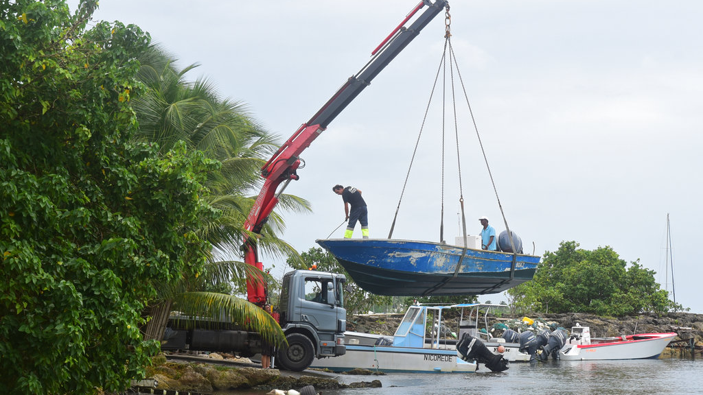 Men remove boats from the water ahead of Hurricane Maria in the Galbas area of Sainte-Anne on the French Caribbean island of Guadeloupe, early Monday, Sept. 18, 2017. (AP Photo/Dominique Chomereau-Lamotte)