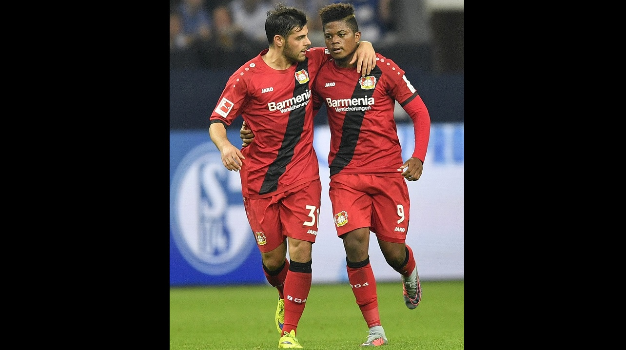 Leverkusen's scorer Leon Bailey, right, celebrates his goal with Leverkusen's Kevin Volland during the German Bundesliga soccer match between FC Schalke 04 and Bayer Leverkusen at the Arena in Gelsenkirchen, Germany, Friday, Sept. 29, 2017. (AP Photo/Martin Meissner)