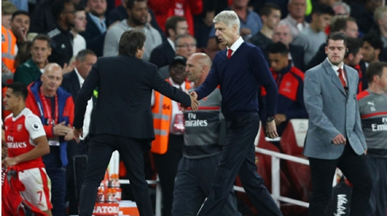 Antonio Conte greets Arsene Wenger.