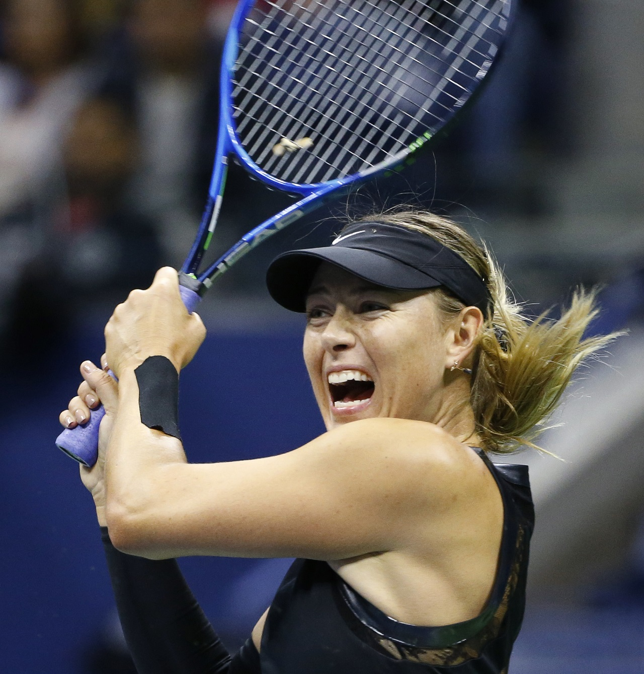 Maria Sharapova, of Russia, follows through on a shot to Sofia Kenin, of the United States, in the first-set tiebreak at the U.S. Open tennis tournament in New York, Friday, Sept. 1, 2017.