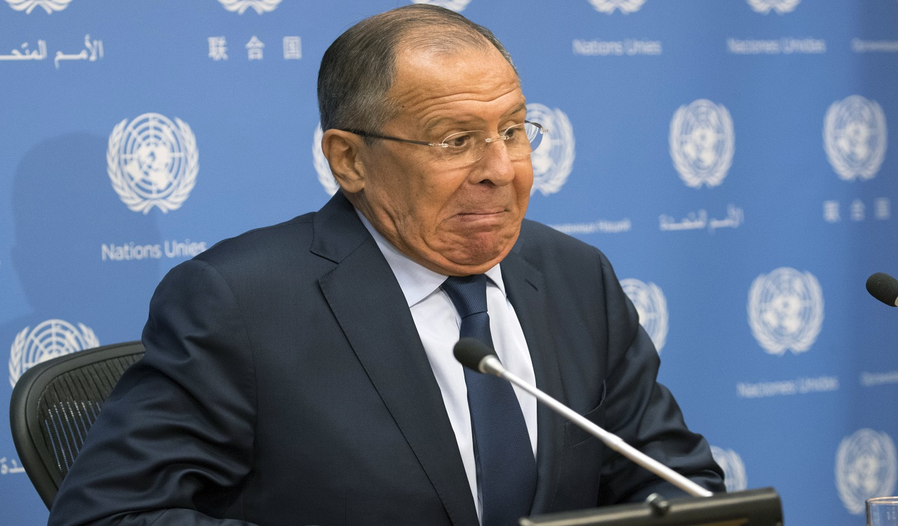 Russian Foreign Minister Sergey Lavrov reacts as he sits on a wobbly chair as he arrives for a news conference at United Nations headquarters, Friday, Sept. 22, 2017.