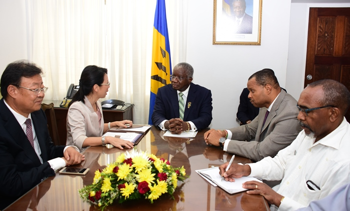Prime Minister Freundel Stuart listening attentively to China's Ambassador to Barbados, Wang Ke, when she paid him a farewell courtesy call. To Mr. Stuart's left is Minister of Finance, Christopher Sinckler; and Minister in the Prime Minister's Office, Senator Darcy Boyce. Commercial Counsellor, Zhang Xin, is next to Ambassador Wang. (PHOTO: BGIS/C.Pitt)