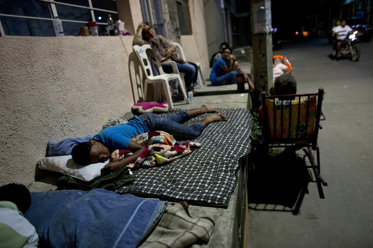 Residents fearing aftershocks sleep on stoops outside their earthquaked-damaged homes in central Juchitan, Oaxaca state, Mexico, Friday, Sept. 8, 2017.