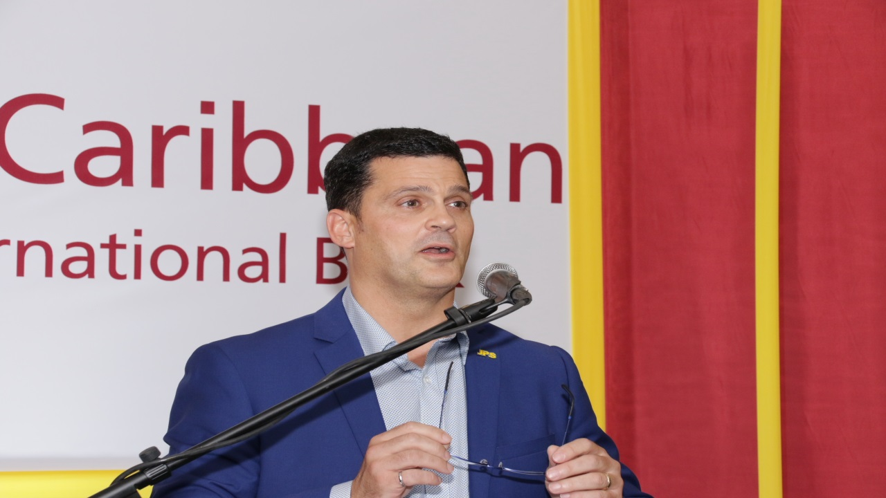 Emanuel DaRosa speaks at the reception hosted by CIBC FirstCaribbean International Bank. (Photos: Llewellyn Wynter)
