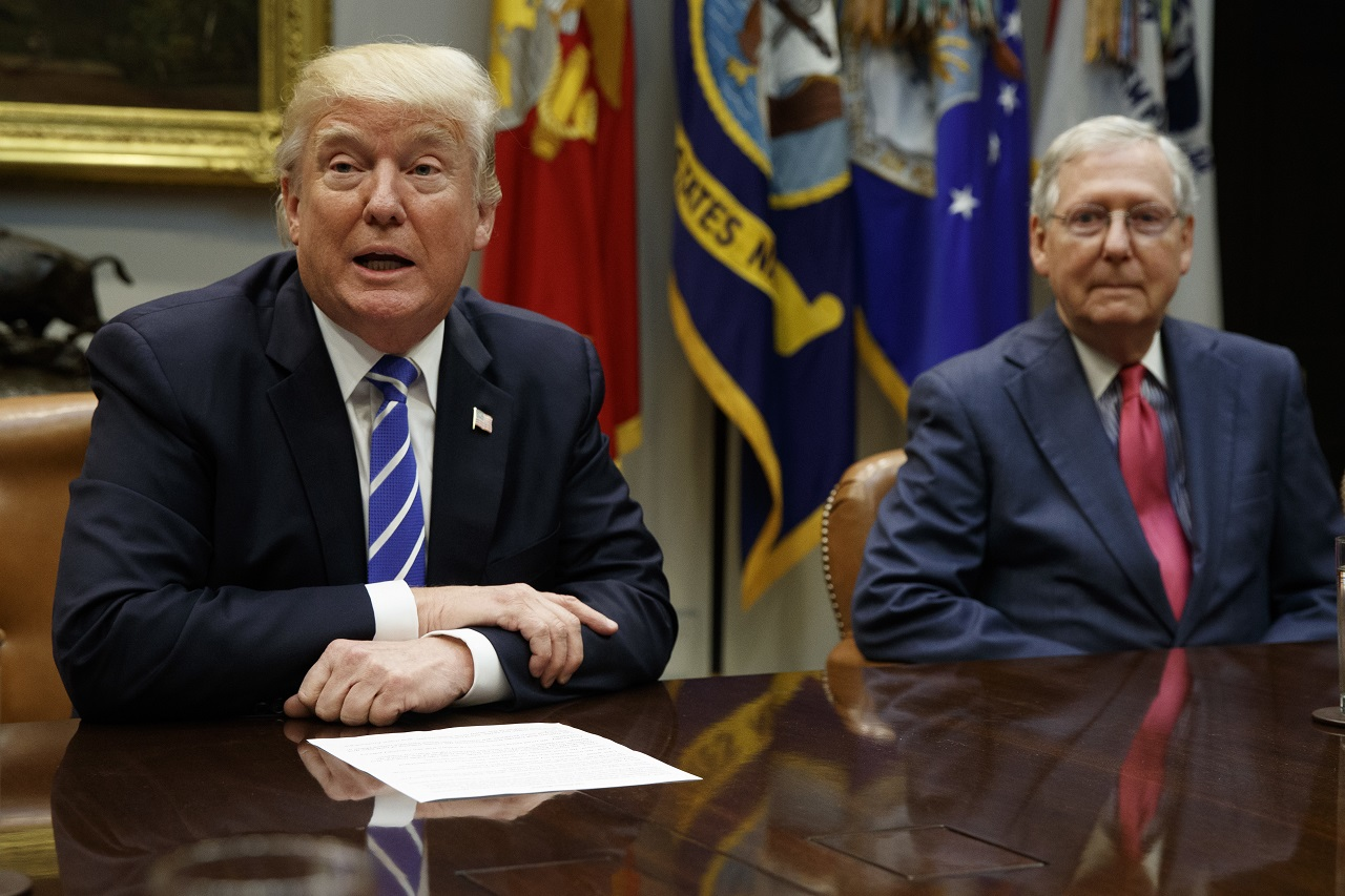 Senate Majority Leader Mitch McConnell, R-Ky., right, listens as President Donald Trump speaks during a meeting with congressional leaders and administration officials on tax reform, in the Roosevelt Room of the White House, Tuesday, Sept. 5, 2017, in Washington.