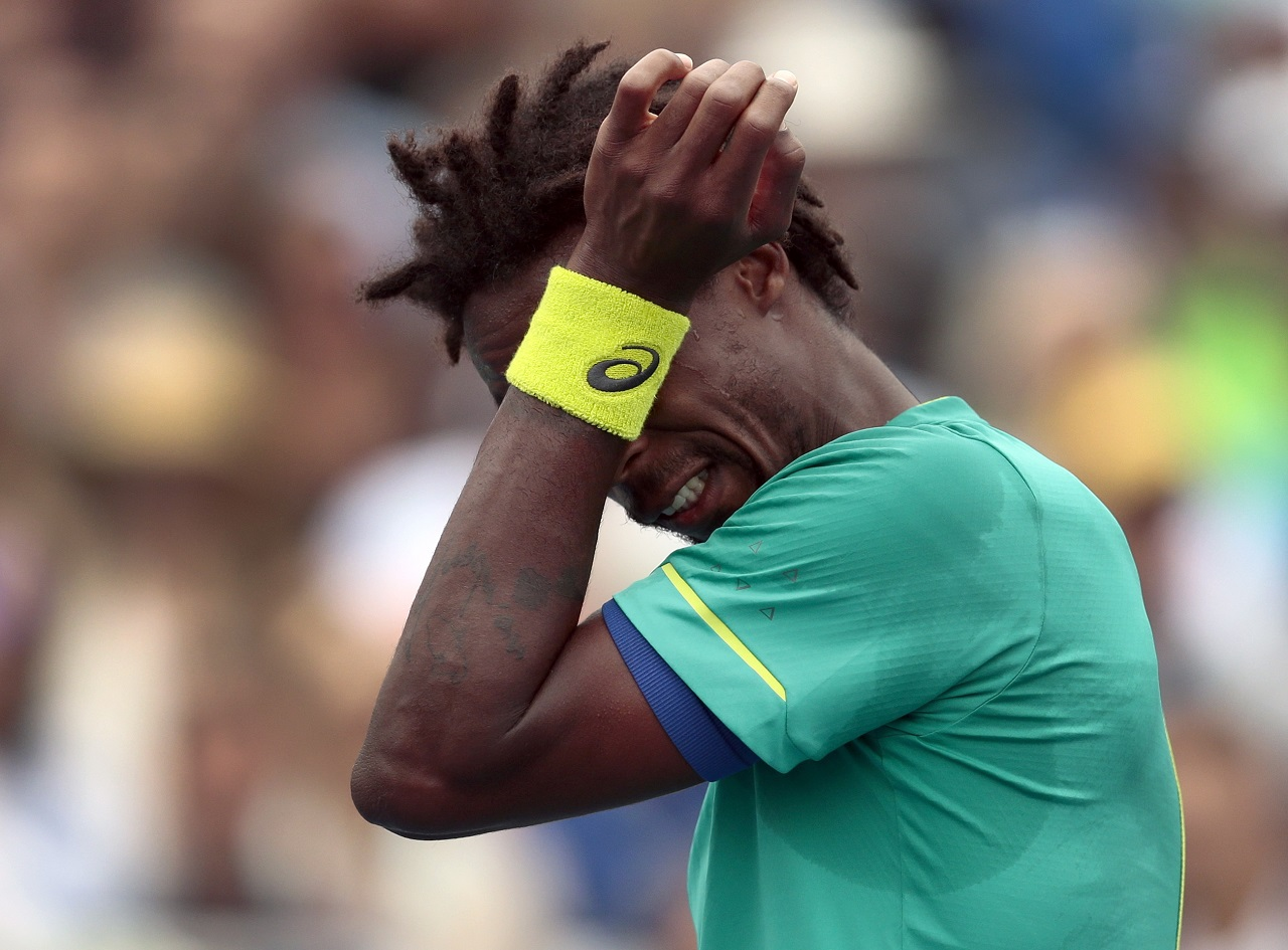 Gael Monfils, of France, wipes sweat from his face during the third round of the U.S. Open tennis tournament against David Goffin, of Belgium, Saturday, Sept. 2, 2017, in New York.