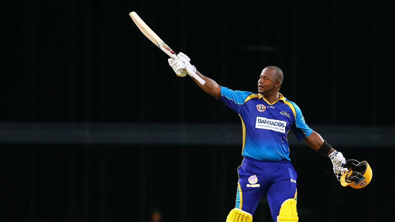 : In this handout image provided by CPL T20, Dwayne Smith of Barbados Tridents celebrates towards the crowd after reaching his century during Match 25 of the 2017 Hero Caribbean Premier League between Barbados Tridents v St Lucia Stars at Kensington Oval on August 31, 2017 in Bridgetown, Barbados. (Photo by Ashley Allen - CPL T20 via Getty Images)
