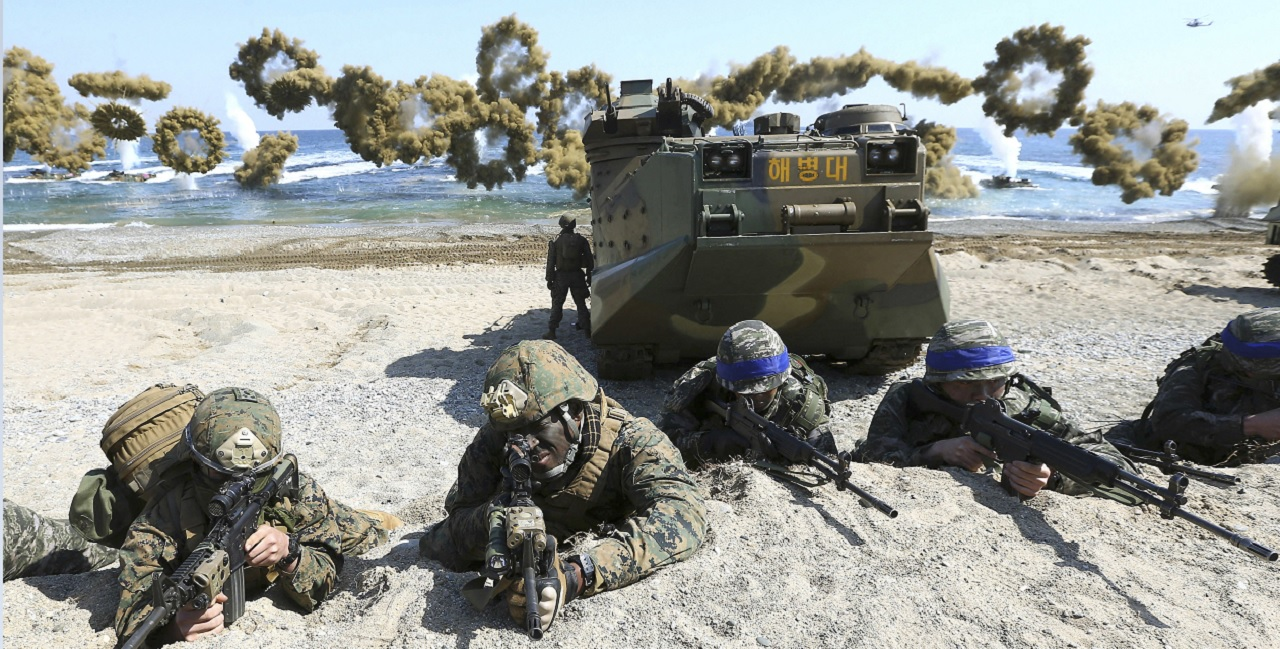 In this March 12, 2016 file photo, Marines of the U.S., left, and South Korea wearing blue headbands on their helmets, take positions after landing on a beach during the joint military combined amphibious exercise, called Ssangyong, part of the Key Resolve and Foal Eagle military exercises, in Pohang, South Korea. America's annual joint military exercises with South Korea always frustrate North Korea.