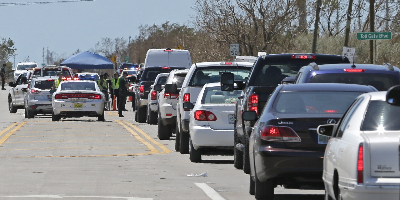 Motorists line up to enter the Florida Keys at a checkpoint in the aftermath of Hurricane Irma, Thursday, Sept. 14, 2017, in Florida City, Fla. Residents of the Florida Keys continue to be turned away.