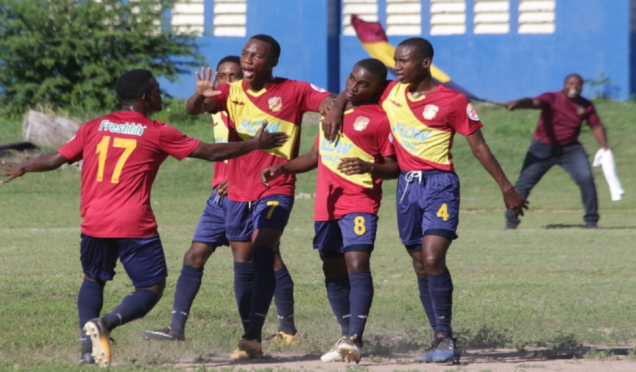 Players from St Andrew Technical High School (STATHS) celebrating their goal against hosts Mona High during Saturday's Group B ISSA/FLOW Manning Cup fixture. STATHS won 1-0.