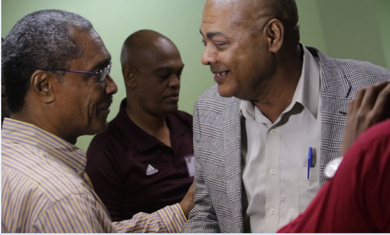 Ambassador Stewart Stephenson (left) congratulates the new president of the Jamaica Football Federation following the voting congress at the offices of the federation on Saturday. Ricketts defeated Stephenson 8 votes to 5.
