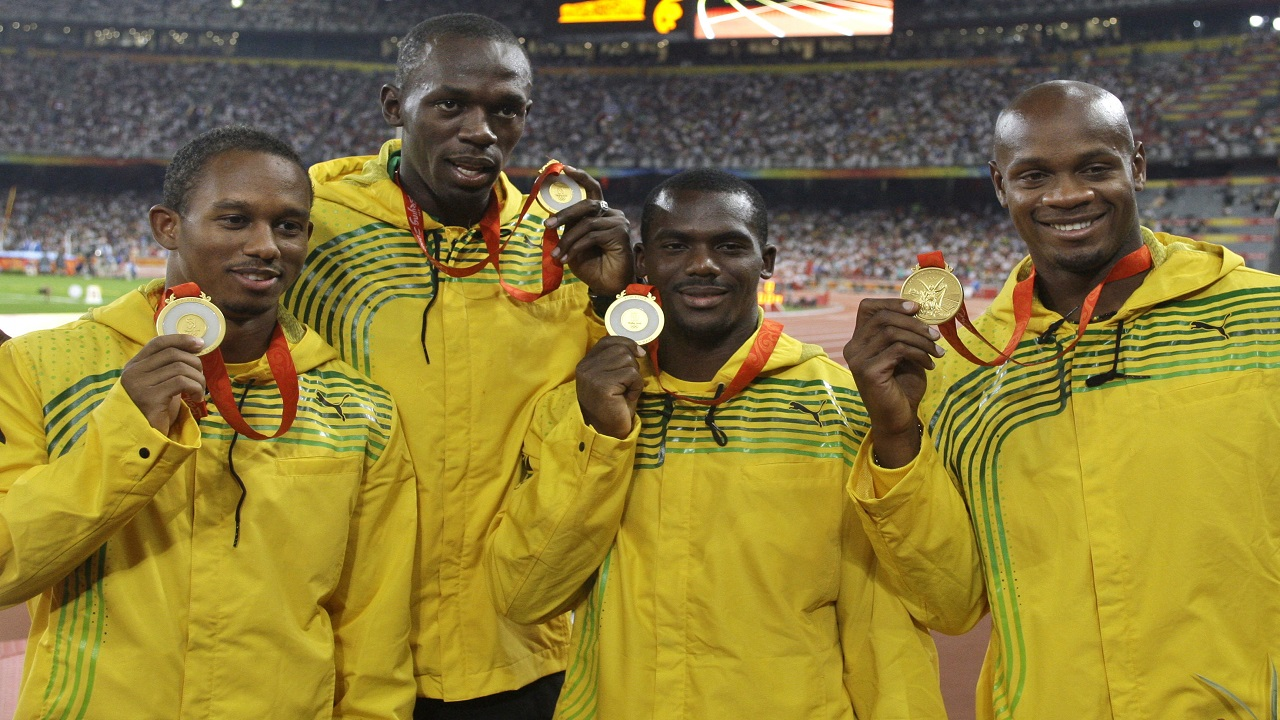 In this Saturday, August 23, 2008 file photo, Jamaica's men's 4x100 meters relay team, from left, Michael Fraser, Usain Bolt, Nesta Carter and Asafa Powell show their gold medals during the athletics competitions in the National Stadium at the Beijing 2008 Olympics in Beijing. An appeal case involving the 2008 Olympic title stripped from Usain Bolt's Jamaica relay team is going to court in November 2017. (AP Photo/Petr David Josek, File)
