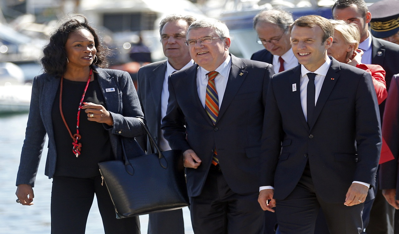 "French President Emmanuel Macron, right, International Olympic Committee (IOC) President Thomas Bach, center, and French Minister for Sports Laura Flessel arrive for a meeting at the city hall as part of a visit to the site of the future Olympic Sailing venue (Voile Olympique) at the ""Marina Olympique"" nautical base in Marseille, southern France, after the decision for Paris to host of the 2024 Summer Olympics Games, Thursday, Sept. 21, 2017."