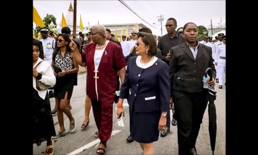 Opposition Leader Kamla Persad-Bissessar walking in the funeral procession of murdered soldier Lance Corporal Marcus Gay