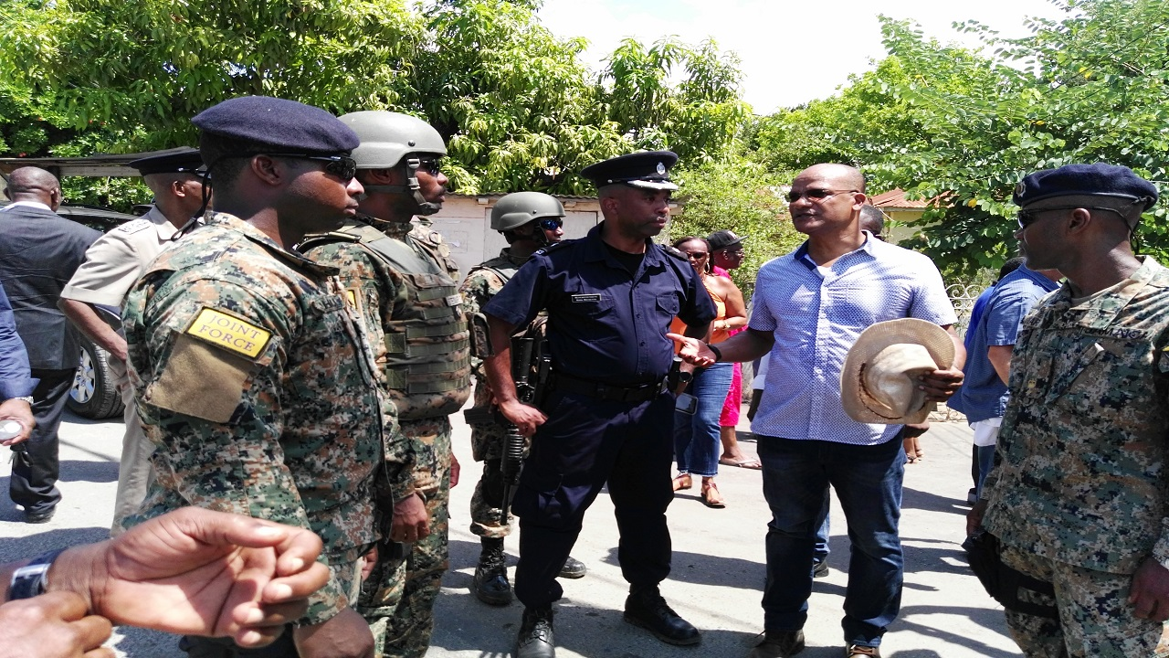 Opposition Spokesman on National Security Peter Bunting speaking to members of the joint police military team in Mount Salem on Wednesday.