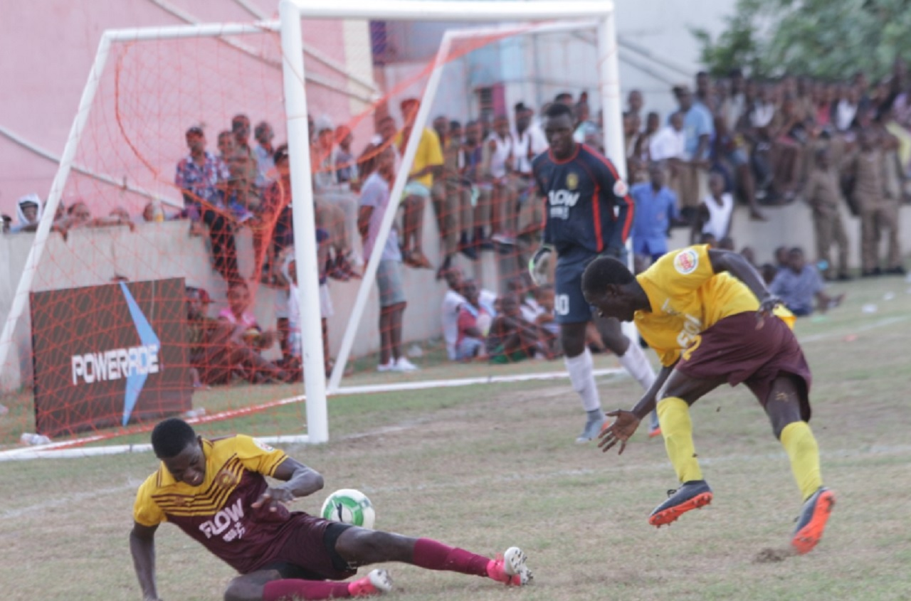 Action from the Group A ISSA/FLOW Manning Cup game between Wolmer's Boys and hosts Haile Selassie on Tuesday.