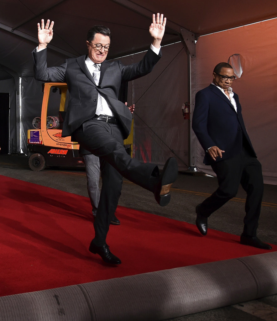 n this Tuesday, Sept. 12, 2017, file photo, Stephen Colbert, left, and Hayma Washington participate in the 2017 Primetime Emmy Red Carpet Rollout at the Microsoft Theater in Los Angeles. The Emmys will be held on Sunday. (Photo by Richard Shotwell/Invision/AP, File)