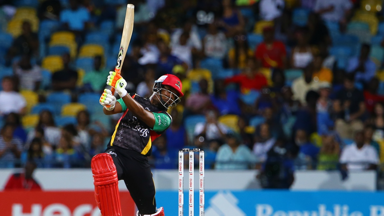 Evin Lewis of the St Kitts and Nevis Patriots plays an attacking shot through the offside en route to 97 not out during Match 30 of the 2017 Hero Caribbean Premier League between Barbados Tridents v St Kitts and Nevis Patriots at Kensington Oval on September 3, 2017 in Bridgetown, Barbados. (PHOTO: Ashley Allen - CPL T20 via Getty Images)