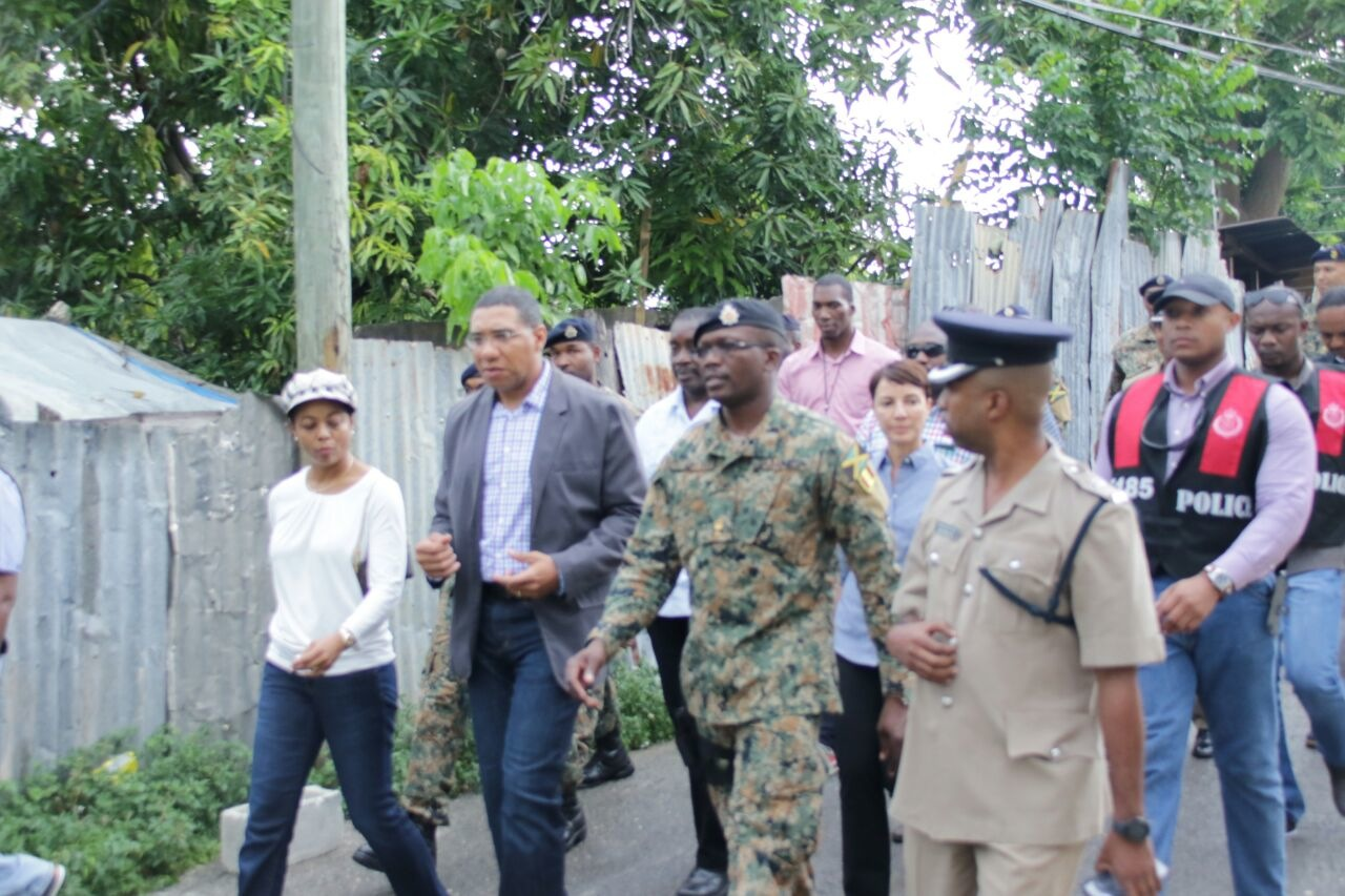 Prime Minister Andrew Holness during a tour of Mount Salem last week, after the area was declared a ZOSO.