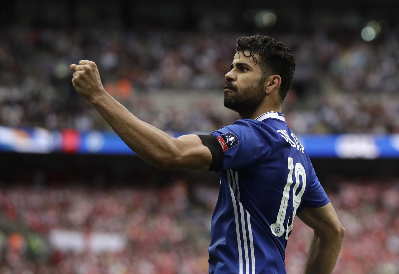 In this Saturday, May 27, 2017 file photo, Chelsea's Diego Costa celebrates scoring his team's equalizer during their English FA Cup final football match against Arsenal at the Wembley stadium in London.
