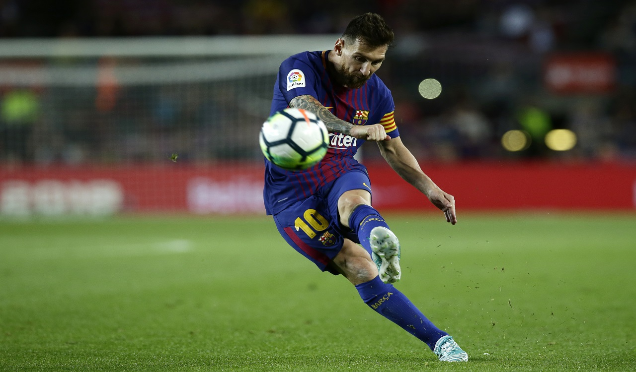 Barcelona's Lionel Messi kicks the ball during the Spanish La Liga soccer match between FC Barcelona and Eibar at the Camp Nou stadium in Barcelona, Spain, Tuesday, Sept. 19, 2017.