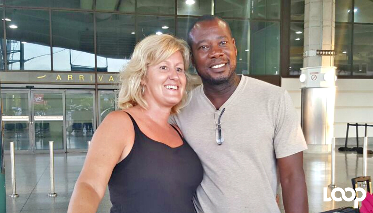 SMILES OF RELIEF: Glenna Smith and Romeo Addison after arriving at the Grantley Adams International Airport Wednesday afternoon.