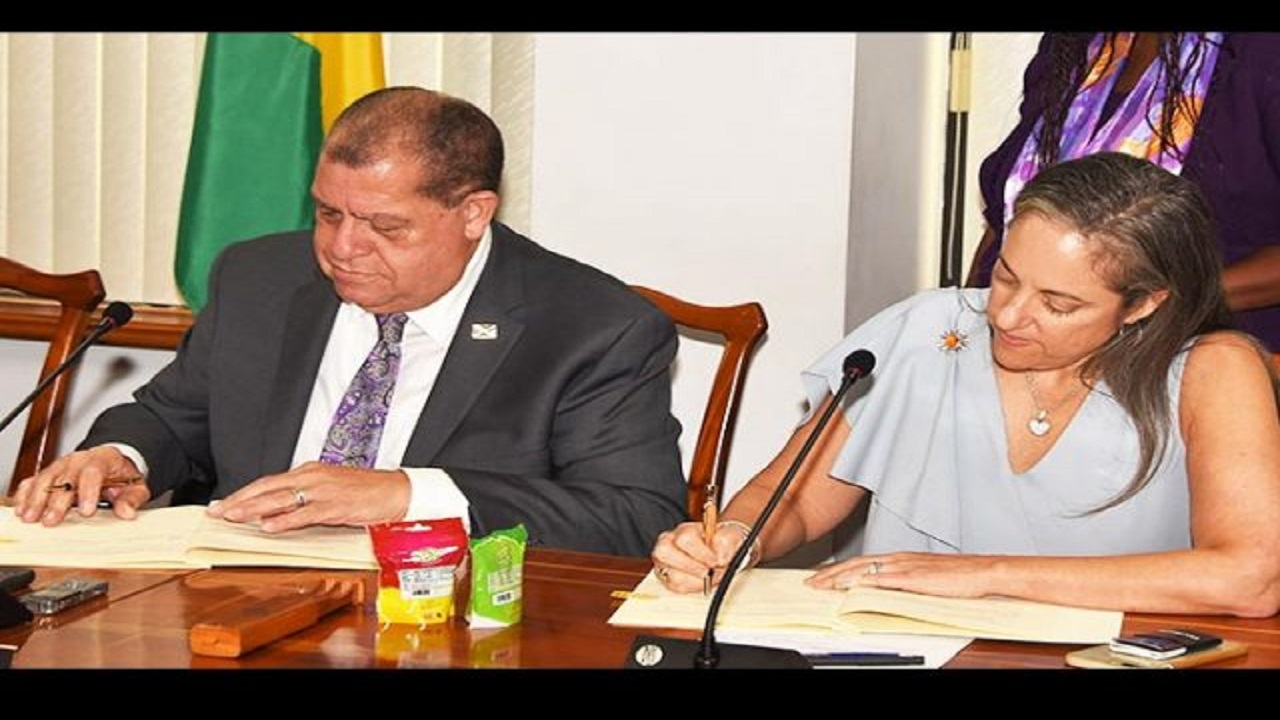 Finance and Public Service Minister Audley Shaw (left), and Inter-American Development Bank (IDB) Executive Vice President, Julie Katzman, sign a J$2.56-billion (US$20-million) IDB loan agreement. Photo via JIS.