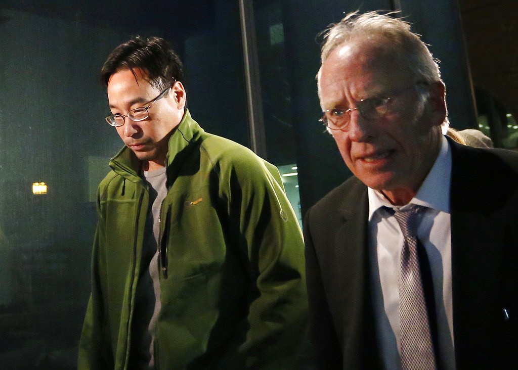 In this Friday, Dec. 19, 2014, file photo the former supervisory pharmacist for the New England Compounding Center, Glenn Chin, left, leaves the federal courthouse in Boston with his attorney Stephen Weymouth after a hearing to announce conditions of his bail and release. He faces up to life in prison if convicted of all counts of second-degree murder under federal racketeering law. (AP Photo/Elise Amendola, File)