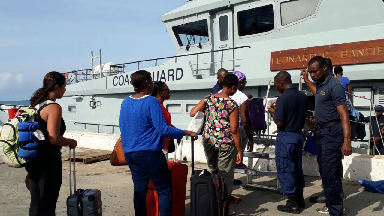 Persons being evacuated from Dominica by the Barbados Coast Guard. (PHOTO: BGIS)