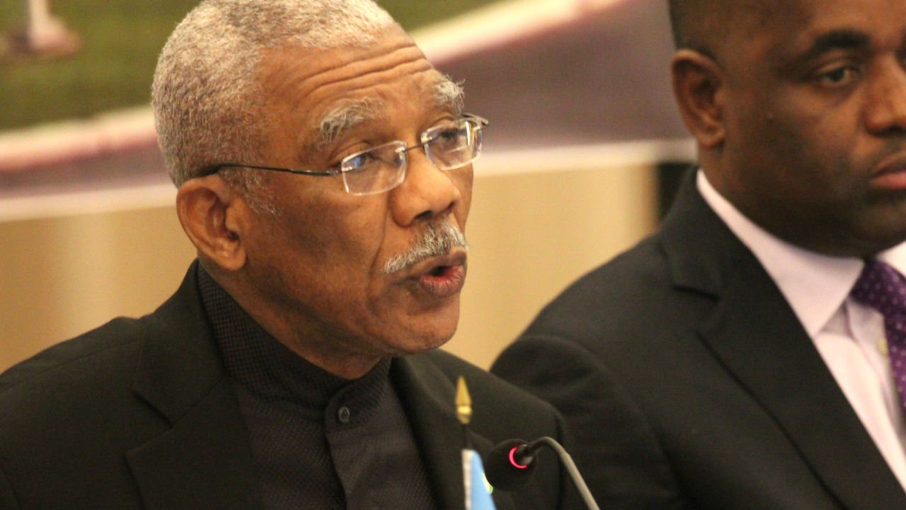 FILE - Guyana's President David Granger at a CARICOM meeting earlier this year. In the background is Dominica's Prime Minister Roosevelt Skerrit.