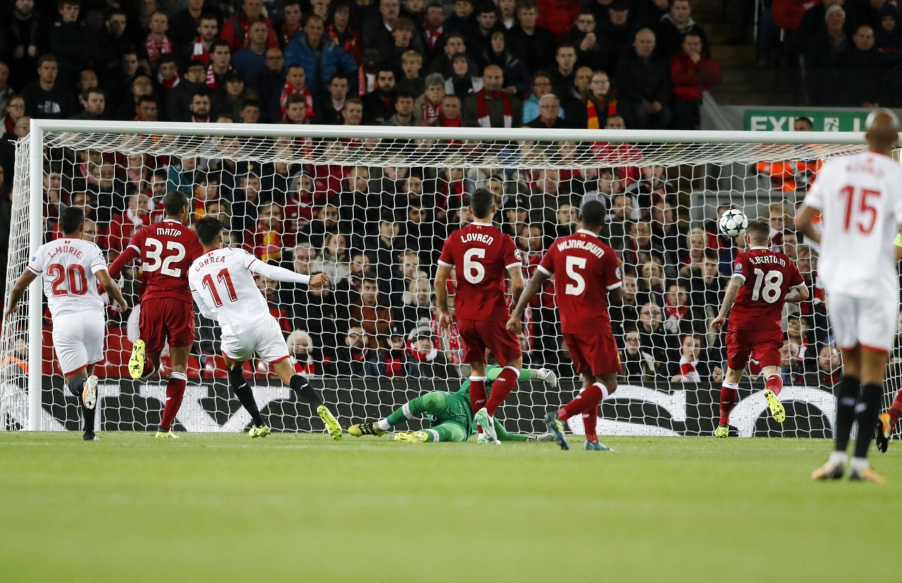 Sevilla's Joaquin Correa, third from left, scores a goal during the Champions League group E  football match against Liverpool at Anfield stadium in Liverpool, England, Wednesday, Sept. 13, 2017.