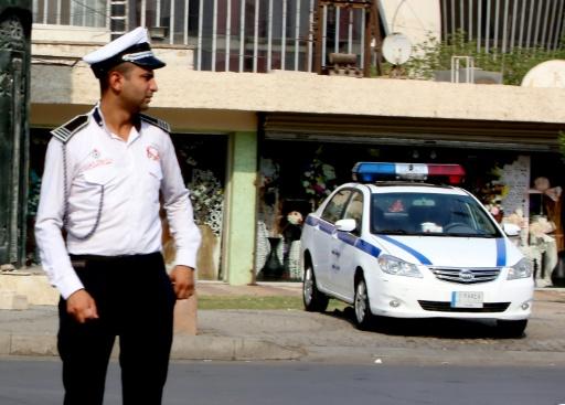 En irak, les policiers sont pris en tenaille entre la loi et les coutumes tribales, ici un policier dans une rue de Bagdad, le 19 septembre 2017