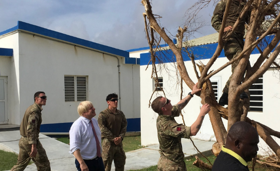 Photo taken from Boris Johnson's Twitter. Caption: At #Anguilla Hospital seeing the #Irma damage & meeting the locals/UK troops repairing it. UK behind the British Overseas Territories 100%.