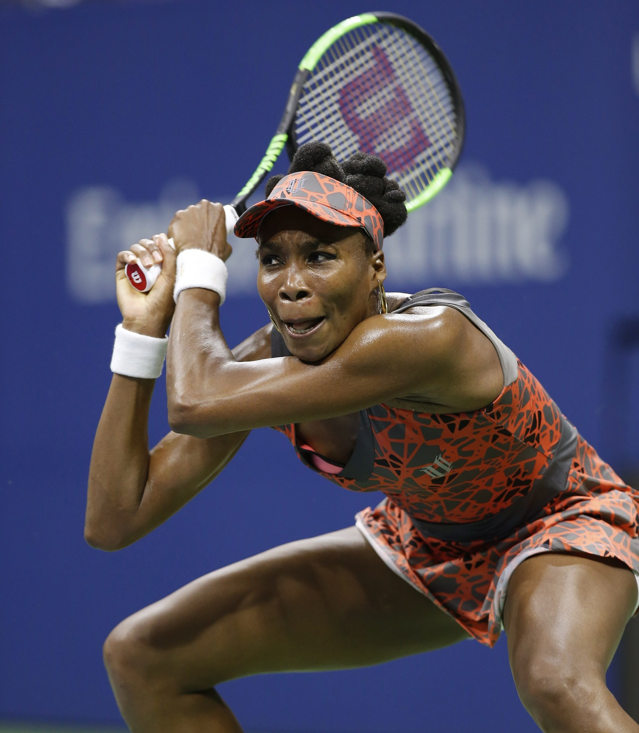 Venus Williams, of the United States, follows through on a return to Petra Kvitova, of the Czech Republic, during the quarterfinals of the U.S. Open tennis tournament in New York, Tuesday, Sept. 5, 2017.