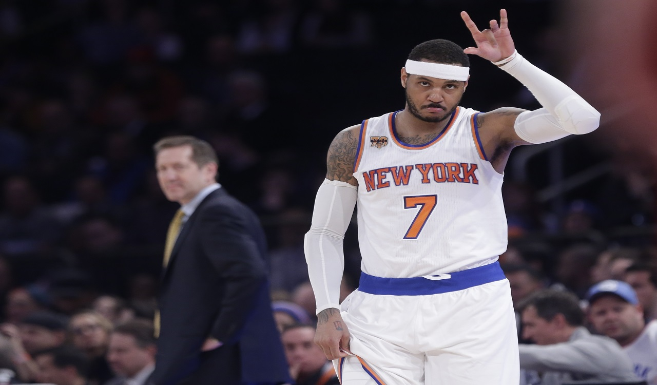 In this April 4, 2017, file photo, New York Knicks' Carmelo Anthony (7) checks in as coach Jeff Hornacek, left, watches during the first half of an NBA basketball game against the Chicago Bulls in New York.