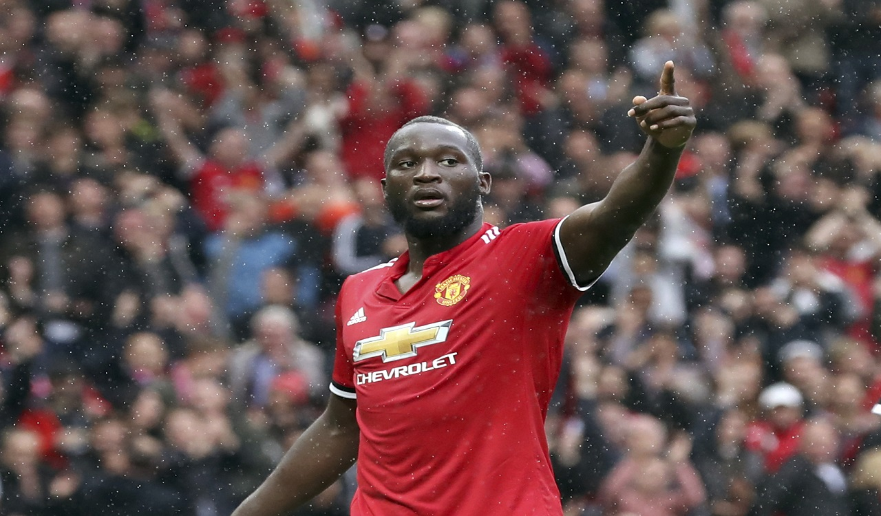 Manchester United's Romelu Lukaku, right, celebrates scoring Manchester United's fourth goal during their English Premier League match against Crystal Palace at Old Trafford, Manchester, England on Saturday, Sept. 30, 2017.