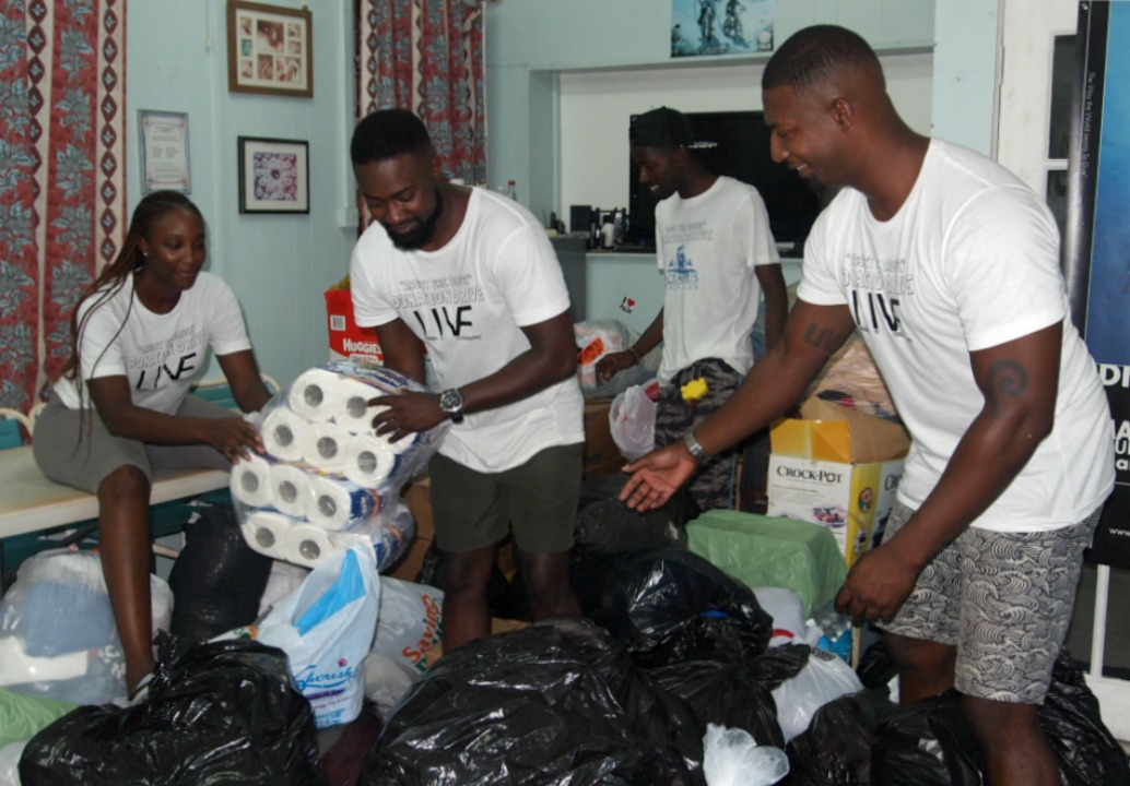 Members of Assist the Cause Barbados (l-r) Nikita Wickham, Avery Brooks, Nicholas Hurley and Evan Brooks sorting donations to be shipped to Irma affected islands.