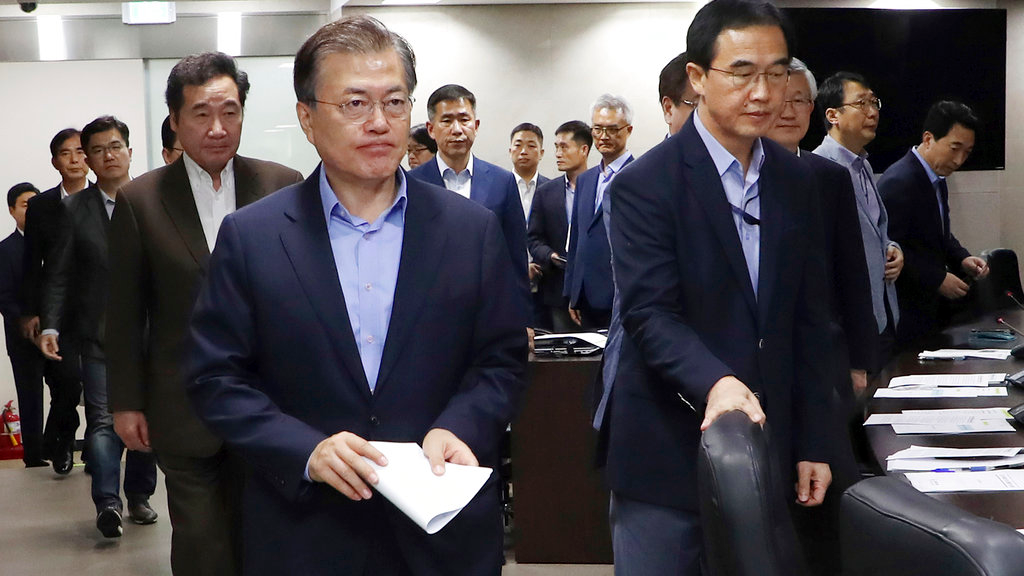 South Korean President Moon Jae-in, left, arrives to presides over a meeting of the National Security Council at the presidential Blue House in Seoul, South Korea, Sunday, Sept. 3, 2017. (Yonhap via AP)