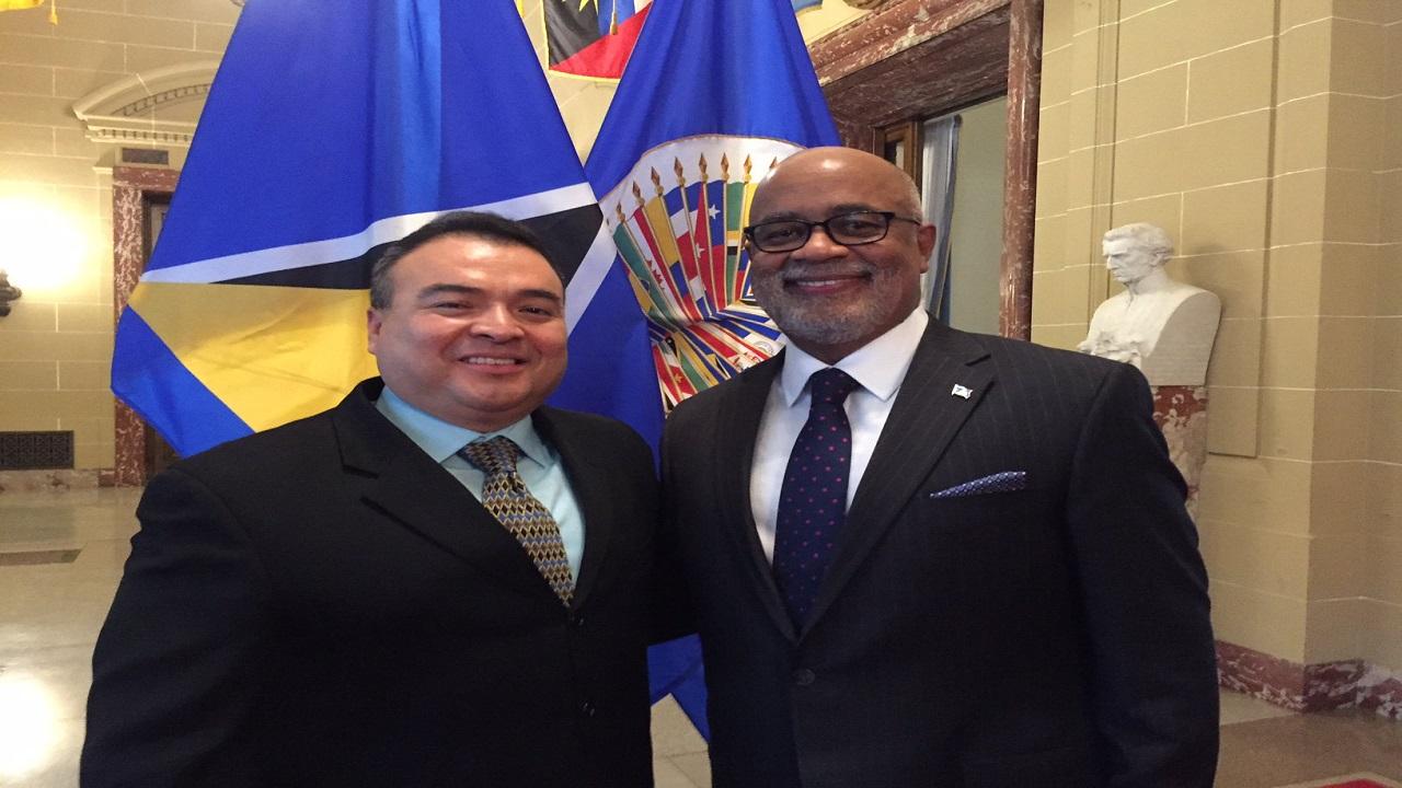 Ambassador Anton E. Edmunds (r) with OAS Assistant Secretary General Nestor Mendez in December 2016