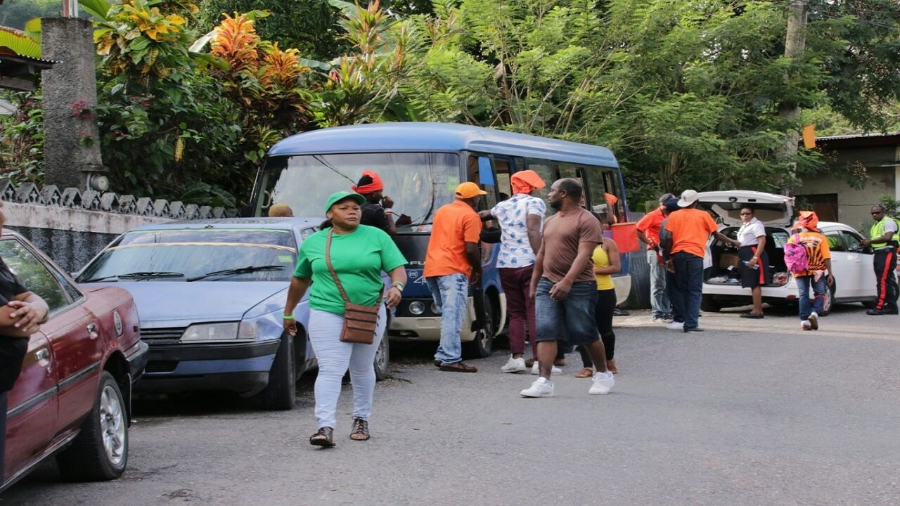 JLP and PNP supporters on Monday morning during voting in South East St Mary. (PHOTOS: Llewellyn Wynter)