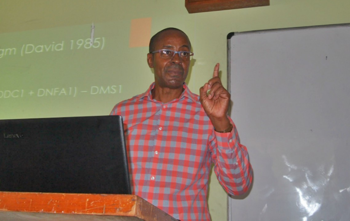 Economist, Dr Clyde Mascoll.
