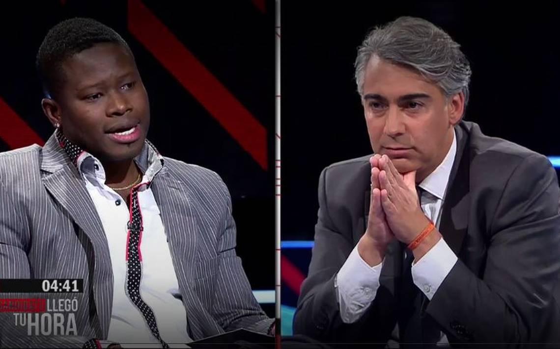 Le journaliste Gyvens Laguerre (g) et le candidat à la présidence chilien Marco Enriquez Ominami (d)./ Credit Photo: 24horas